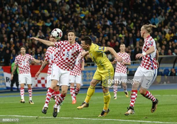 Yevhen Konoplyanka of Ukraine vies Croatiaa's defender Matej Mitrovic and Domagoj Vida during the FIFA 2018 World Cup Group I Qualifier between...