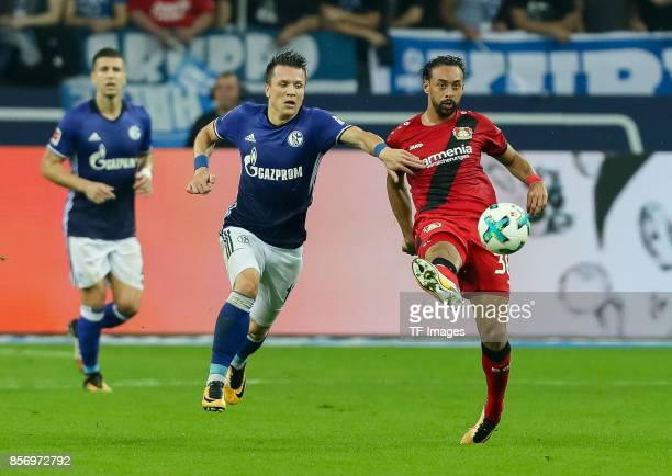 Yevhen Konoplyanke of Schalke and Karim Bellarabi of Leverkusen battle for the ball during the Bundesliga match between FC Schalke 04 and Bayer 04...