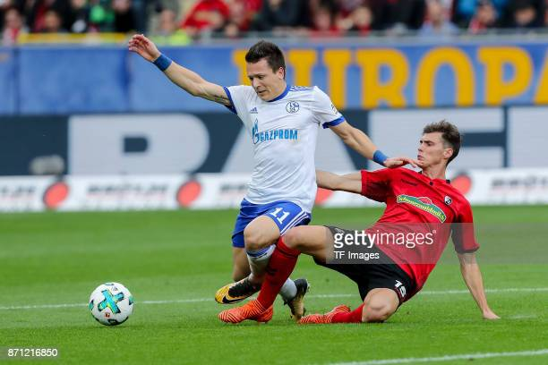 Yevhen Konoplyanke of Schalke and Pascal Stenzel of Freiburg battle for the ball during the Bundesliga match between SportClub Freiburg and FC...