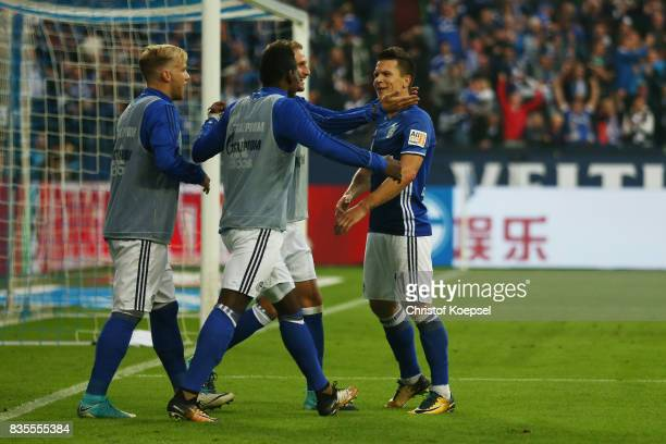 Yevhen Konoplynka of Schalke celebrates his goal to make it 20 with Schalke substitutes during the Bundesliga match between FC Schalke 04 and RB...