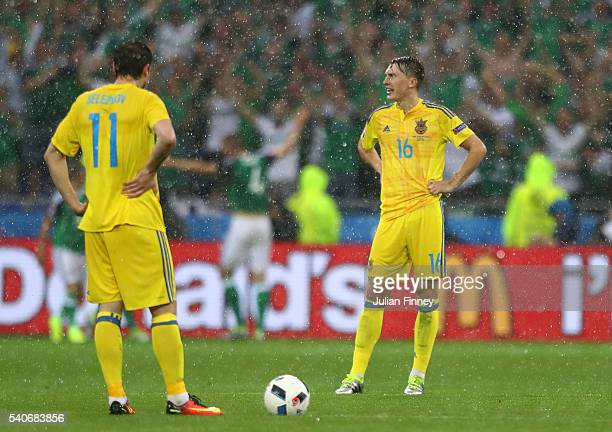 Yevhen Seleznyov and Serhiy Sydorchuk of Ukraine show their dejection after Northern Ireland's first goal during the UEFA EURO 2016 Group C match...