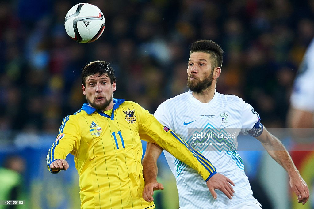Yevhen Seleznyov from Ukraine fights for the ball with Bostjan Cesar of Slovenia during the UEFA EURO 2016 Playoff for Final Tournament First leg...