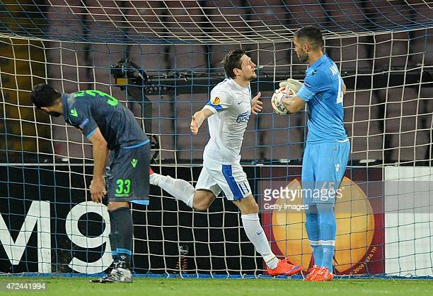 Yevhen Seleznyov of Dnipro Dnipropetrovsk celebrates after scoring the equalizing 11 goal as Raul Albiol of Napoli shows his dejection during the...