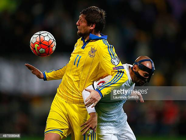 Yevhen Seleznyov of Ukraine battles with Miso Brecko of Slovenia during the UEFA EURO 2016 qualifier playoff second leg match between Slovenia and...