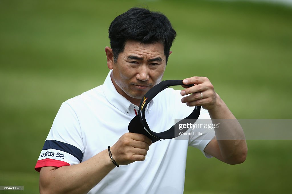 Yang of Korea celebrates a birdie on the 18th green during day one of the BMW PGA Championship at Wentworth on May 26, 2016 in Virginia Water, England.