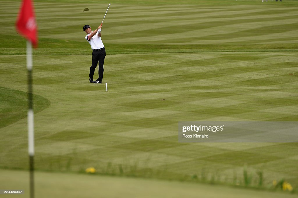 Yang of Korea hits his approach to the 18th green during day one of the BMW PGA Championship at Wentworth on May 26, 2016 in Virginia Water, England.