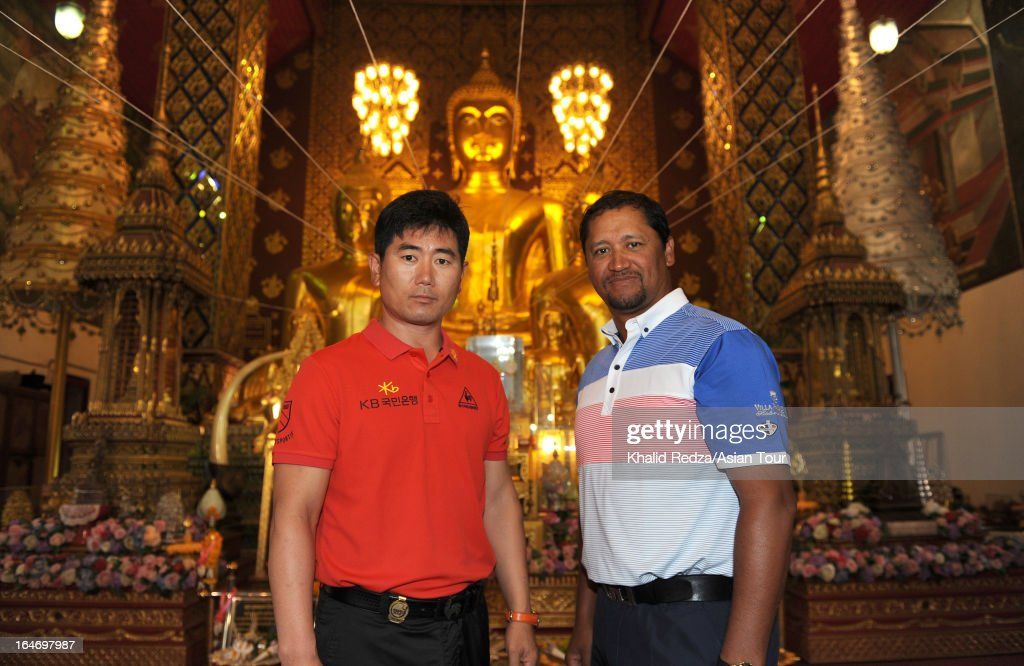 YEYang of South Korea and Michael Campbell of New Zealand visit the Wat Phrathat Hariphunchai Lamphun Temple ahead of the Chiangmai Golf Classic at...