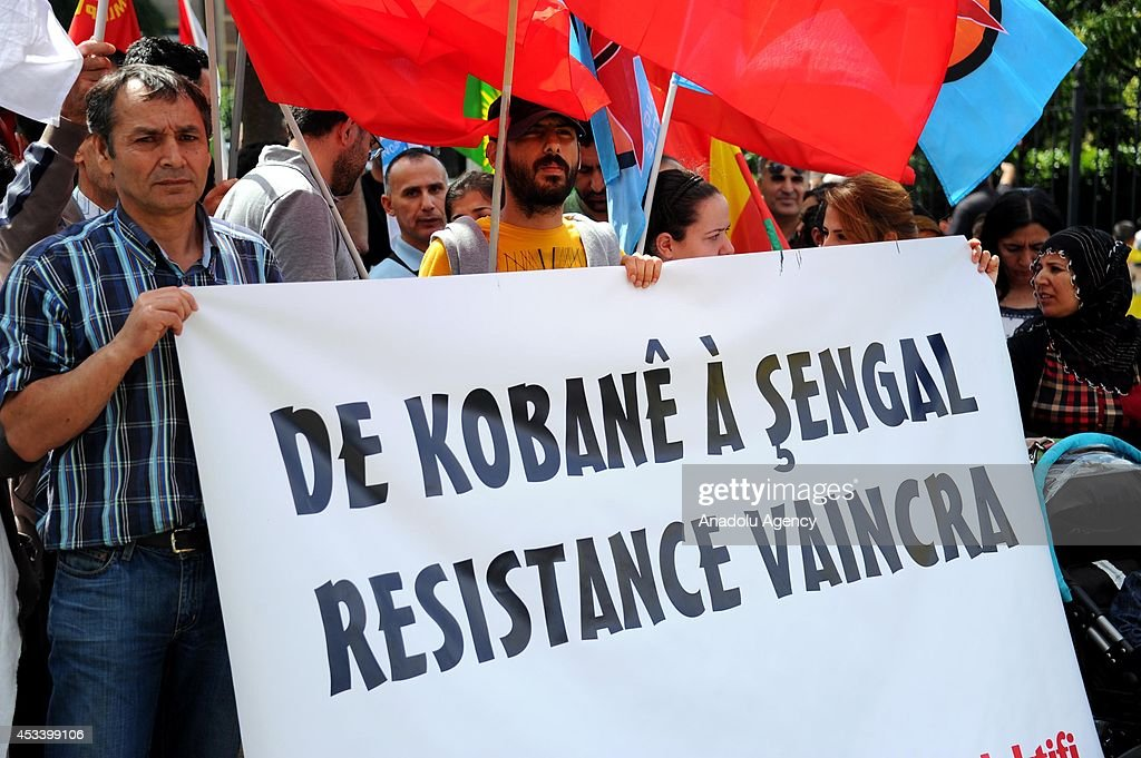 Yezidis living in Belgium, protest the attacks of Islamic State of Iraq and the Levant (ISIL) to Yezidis in Iraq, Brussels, Belgium on 9 August, 2014.