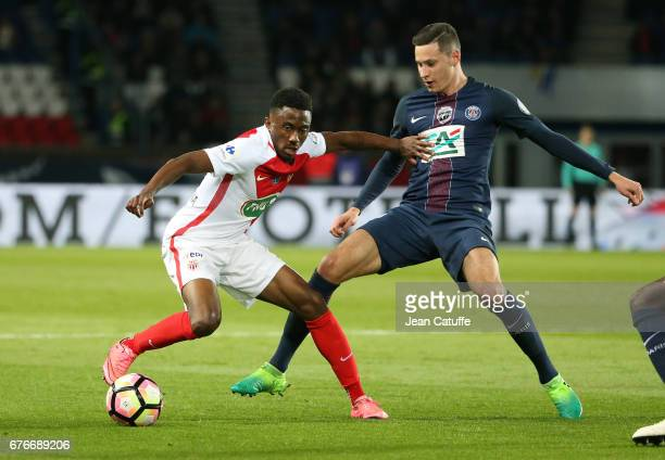 Yhoan Andzouana of Monaco and Julian Draxler of PSG in action during the French Cup semifinal match between Paris SaintGermain and AS Monaco at Parc...