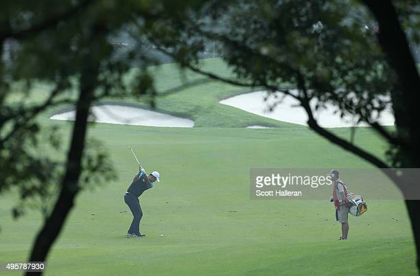 Yi Cao hits a shot from the second fairway during the first round of the WGC HSBC Champions at theSheshan International Golf Club on November 5 2015...