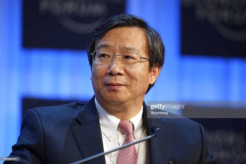 Yi Gang, deputy governor of the People's Bank of China, listens during a session on the final day of the World Economic Forum (WEF) in Davos, Switzerland, on Saturday, Jan. 26, 2013. World leaders, influential executives, bankers and policy makers attend the 43rd annual meeting of the World Economic Forum in Davos, the five day event runs from Jan. 23-27. Photographer: Jason Alden/Bloomberg via Getty Images