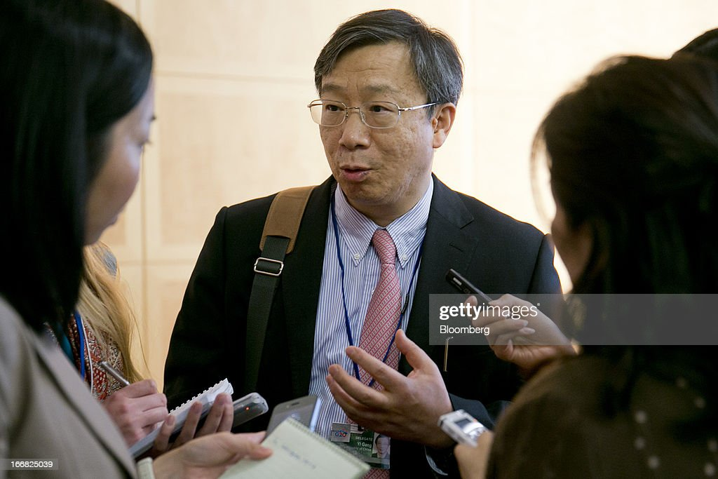 Yi Gang, deputy governor of the People's Bank of China, speaks to reporters at a macro policy discussion during the International Monetary Fund (IMF) and World Bank Group Spring Meetings in Washington, D.C., U.S., on Wednesday, April 17, 2013. As much as 20 percent of non-bank corporate debt in the weakest euro-area economies is unsustainable and may force companies to cut dividends and sell assets, dealing further blows to investor confidence, the IMF said. Photographer: Andrew Harrer/Bloomberg via Getty Images