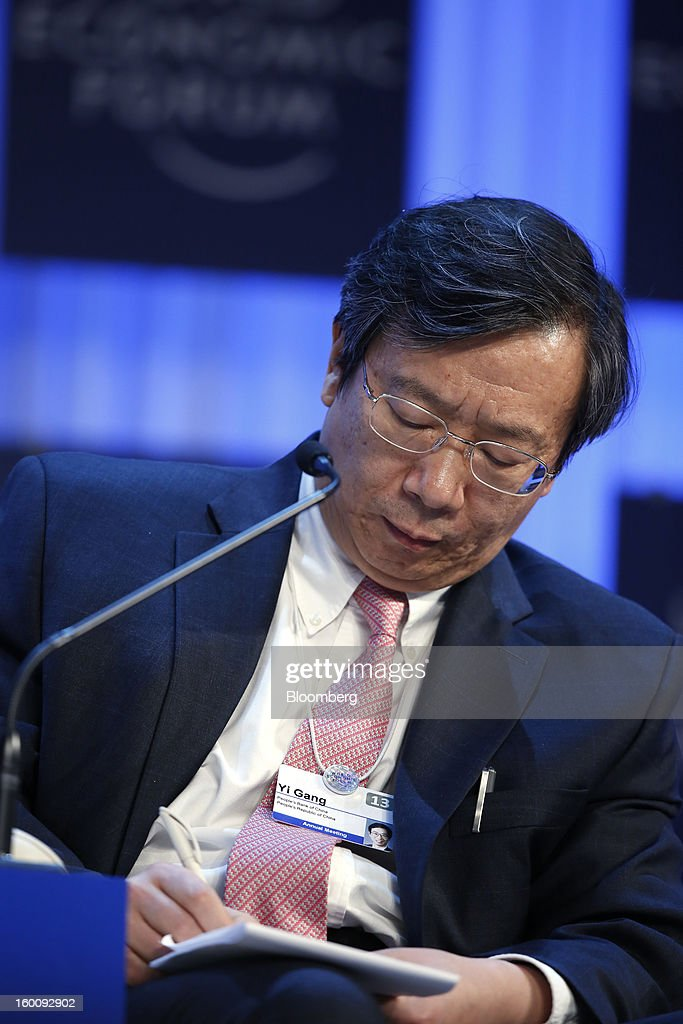 Yi Gang, deputy governor of the People's Bank of China, takes notes during a session on the final day of the World Economic Forum (WEF) in Davos, Switzerland, on Saturday, Jan. 26, 2013. World leaders, influential executives, bankers and policy makers attend the 43rd annual meeting of the World Economic Forum in Davos, the five day event runs from Jan. 23-27. Photographer: Jason Alden/Bloomberg via Getty Images
