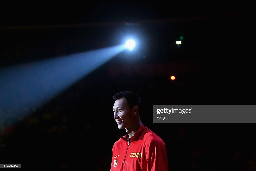 <a gi-track='captionPersonalityLinkClicked' href=/galleries/search?phrase=Yi+Jianlian&family=editorial&specificpeople=646125 ng-click='$event.stopPropagation()'>Yi Jianlian</a> of China attends the 2013 Yao Foundation Charity Game between China and the NBA Stars on July 1, 2013 in Beijing, China.