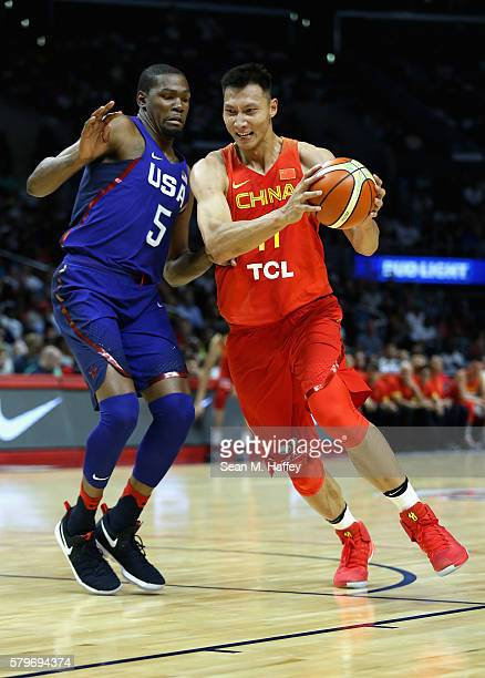 Yi Jianlian of China drives to the basket against Kevin Durant of the United states during the first half of a USA Basketball showcase exhibition...