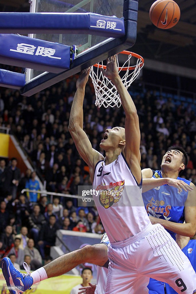 <a gi-track='captionPersonalityLinkClicked' href=/galleries/search?phrase=Yi+Jianlian&family=editorial&specificpeople=646125 ng-click='$event.stopPropagation()'>Yi Jianlian</a> #9 of Guangdong Southern Tigers drives to the basket during the 11th round of the CBA 12/13 game against Shanghai Sharks at Dongguan Stadium on December 18, 2012 in Donggang, China.