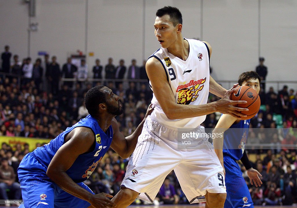 <a gi-track='captionPersonalityLinkClicked' href=/galleries/search?phrase=Yi+Jianlian&family=editorial&specificpeople=646125 ng-click='$event.stopPropagation()'>Yi Jianlian</a> #9 of Guangdong Southern Tigers handles the ball during the 11th round of the CBA 12/13 game against Shanghai Sharks at Dongguan Stadium on December 18, 2012 in Donggang, China.