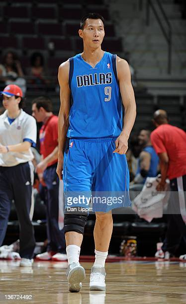 Yi Jianlian of the Dallas Mavericks looks on during the fourth quarter against the Detroit Pistons on January 10 2012 at The Palace of Auburn Hills...