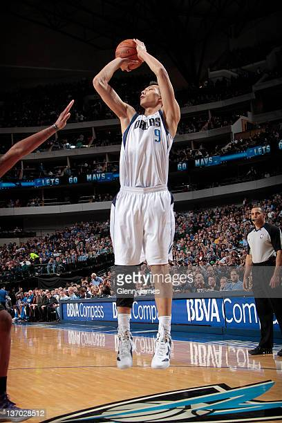 Yi Jianlian of the Dallas Mavericks shoots a jumper against the Sacramento Kings on January 14 2012 at the American Airlines Center in Dallas Texas...