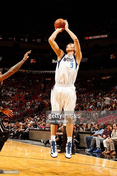 Yi Jianlian of the Dallas Mavericks shoots against the Miami Heat on March 29 2012 at American Airlines Arena in Miami Florida NOTE TO USER User...