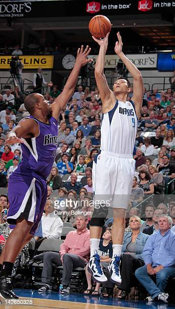 Yi Jianlian of the Dallas Mavericks shoots the ball against Chuck Hayes of the Sacramento Kings on April 10 2012 at the American Airlines Center in...