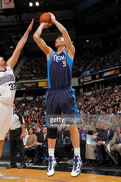 Yi Jianlian of the Dallas Mavericks shoots the ball over Francisco Garcia of the Sacramento Kings on March 09 2012 at Power Balance Pavilion in...