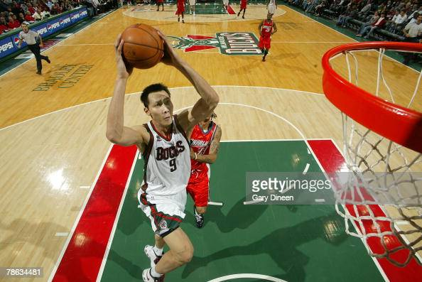Yi Jianlian of the Milwaukee Bucks dunks after stealing the ball in the third quarter against the Charlotte Bobcats at the Bradley Center December 22...