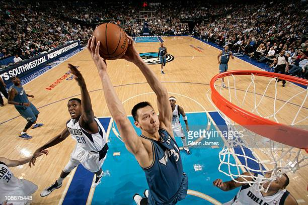 Yi Jianlian of the Washington Wizards dunks against Ian Mahinmi of the Dallas Mavericks on January 31 2011 at the American Airlines Center in Dallas...