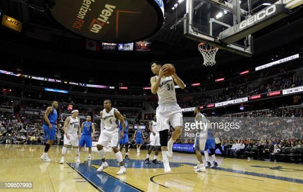 Yi Jianlian of the Washington Wizards pulls down a rebound against the Dallas Mavericks at the Verizon Center on February 26 2011 in Washington DC...