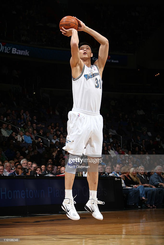 <a gi-track='captionPersonalityLinkClicked' href=/galleries/search?phrase=Yi+Jianlian&family=editorial&specificpeople=646125 ng-click='$event.stopPropagation()'>Yi Jianlian</a> #31 of the Washington Wizards shoots against the Oklahoma City Thunder at the Verizon Center on March 14, 2011 in Washington, DC.