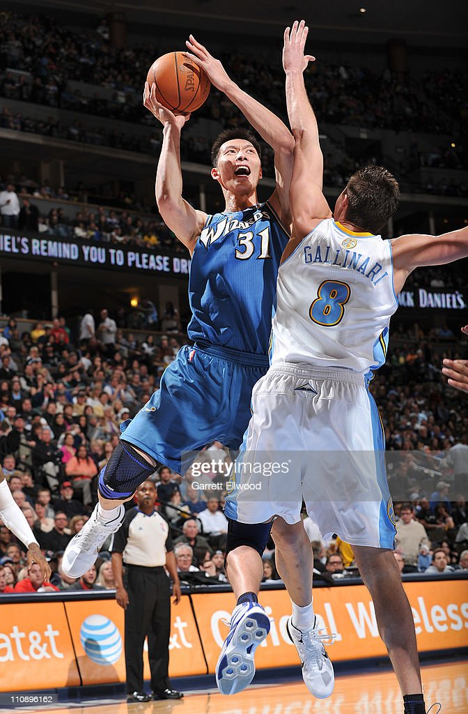 <a gi-track='captionPersonalityLinkClicked' href=/galleries/search?phrase=Yi+Jianlian&family=editorial&specificpeople=646125 ng-click='$event.stopPropagation()'>Yi Jianlian</a> #31 of the Washington Wizards takes a shot against <a gi-track='captionPersonalityLinkClicked' href=/galleries/search?phrase=Danilo+Gallinari&family=editorial&specificpeople=4644476 ng-click='$event.stopPropagation()'>Danilo Gallinari</a> #8 of the Denver Nuggets on March 25, 2011 at the Pepsi Center in Denver, Colorado.
