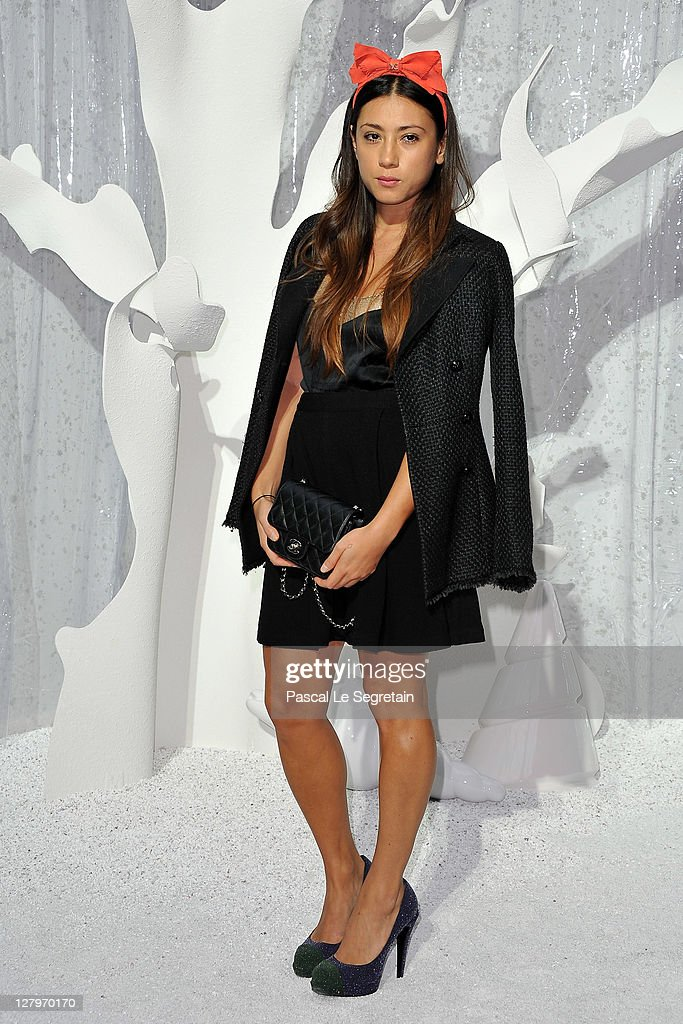 Yi Zhou attends the Chanel Ready to Wear Spring / Summer 2012 show during Paris Fashion Week at Grand Palais on October 4, 2011 in Paris, France.