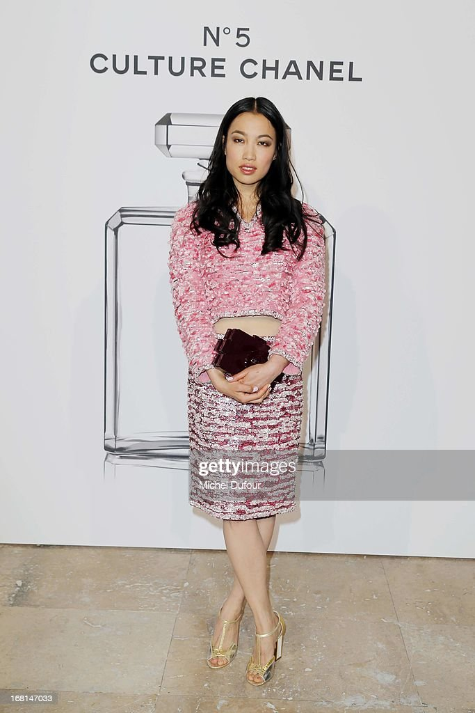 Yi Zhou attends the 'No5 Culture Chanel' Exhibition - Photocall at Palais De Tokyo on May 3, 2013 in Paris, France.