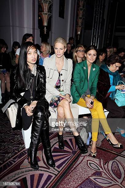 Yi Zhou Poppy Delevingne and Olivia Palermo sit in the front row at The Anya Hindmarch Pomp Pleasure SS13 Collection Show at The Sheridan Park Lane...