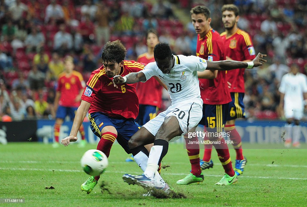 Yiadom Boake of Ghana shoots under pressure from Isreal Puerto of Spain during the FIFA U-20 World Cup Group A match between Spain and Ghana at the Ali Sami Yen Arena on June 24, 2013 in Istanbul, Turkey.