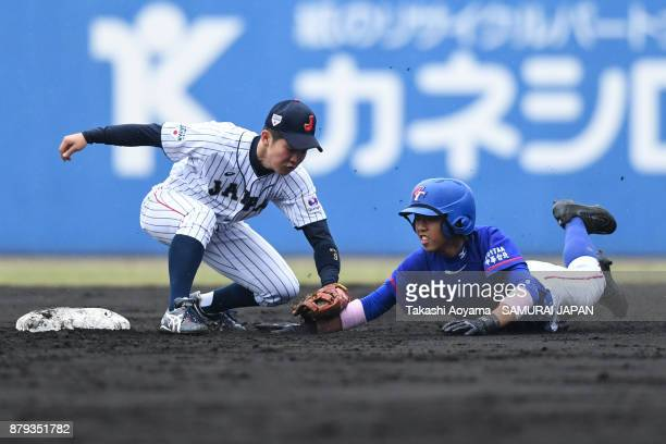 YiAn Liao of Chinese Taipei is tagged out by Ichita Nagumo of Japan at second base in the second inning during the U15 Asia Challenge Match between...