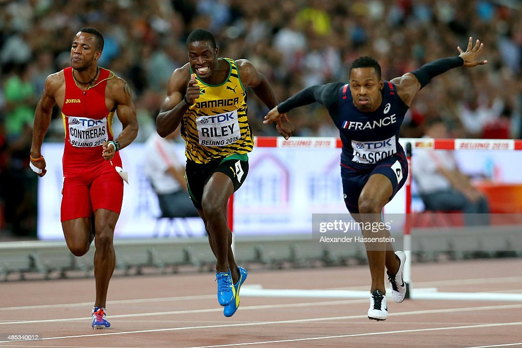 Yidiel Contreras of Spain, <a gi-track='captionPersonalityLinkClicked' href=/galleries/search?phrase=Andrew+Riley&family=editorial&specificpeople=8100073 ng-click='$event.stopPropagation()'>Andrew Riley</a> of Jamaica and <a gi-track='captionPersonalityLinkClicked' href=/galleries/search?phrase=Dimitri+Bascou&family=editorial&specificpeople=5949069 ng-click='$event.stopPropagation()'>Dimitri Bascou</a> of France compete in the Men's 110 metres hurdles semi-final during day six of the 15th IAAF World Athletics Championships Beijing 2015 at Beijing National Stadium on August 27, 2015 in Beijing, China.