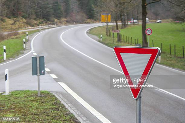 A yield road sign in a European road