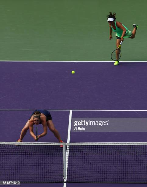 Yifan Xu of China and Gabriela Dabrowski of Canada in action against Andrea Hlavackova of the Czech Republic and Shuai Peng of China during Day 12 of...