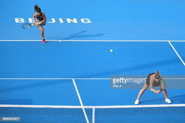 Yifan Xu of China and Gabriela Dabrowski of Canada serve against YungJan Chan of Chinese Taipei and Martina Hingis of Switzerl during their Women's...