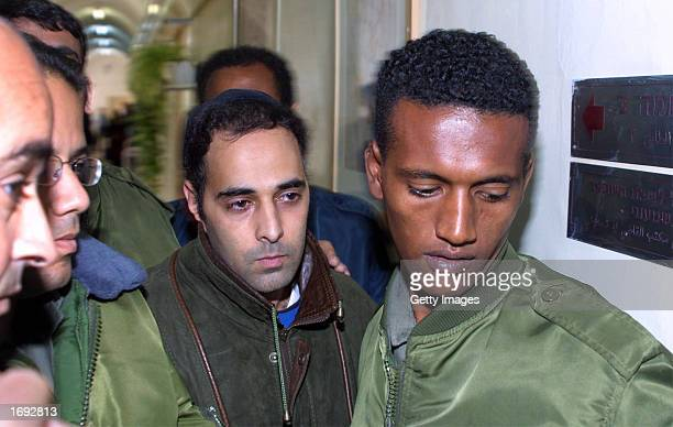 Yigal Amir the convicted assassin of Israeli Prime Minister Yitzhak Rabin is escorted into Magistrate's Court to testify for former Israeli Shin Bet...