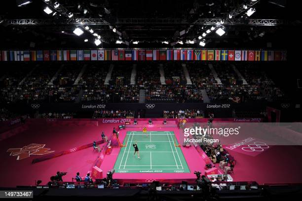 Yihan Wang of China and Saina Nehwal of India compete in the Women's Singles Badminton SemiFina on Day 7 of the London 2012 Olympic Games at Wembley...