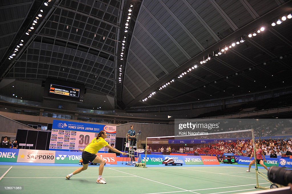 Yihan Wang of China competes in the Women's Singles final match against <a gi-track='captionPersonalityLinkClicked' href=/galleries/search?phrase=Juliane+Schenk&family=editorial&specificpeople=653201 ng-click='$event.stopPropagation()'>Juliane Schenk</a> of Germany during day five of the Yonex Open Japan 2011 at Tokyo Metropolitan Gymnasium on September 25, 2011 in Tokyo, Japan.