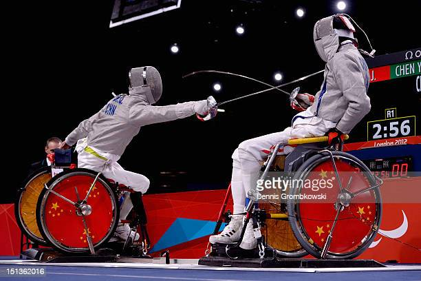 Yijun Chen of China and teammate Jianquan Tian compete in the Men's Individual Sabre Wheelchair Fencing Category A final on day 8 of the London 2012...