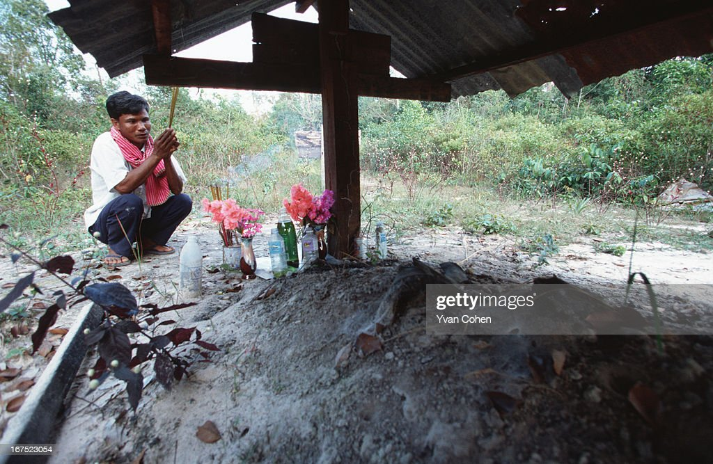 Yim Dorl, the man who built the houses of Pol Pot and the infamous Ta Mok, pays homage with a prayer to the ashes of his dead leader at the site of his cremation..