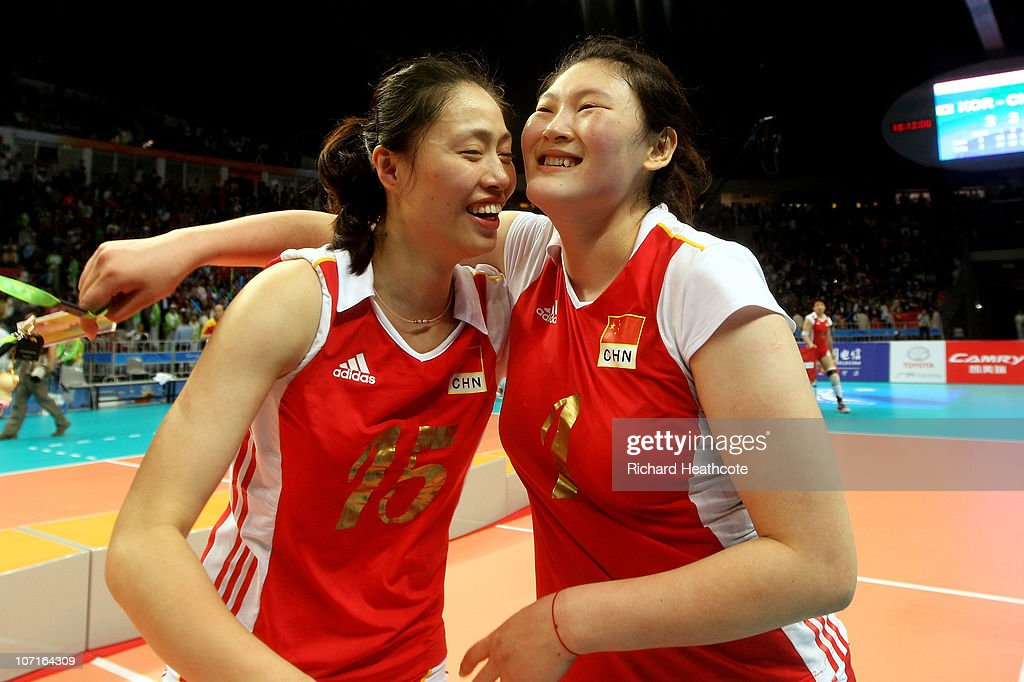 Yimei Wang and <a gi-track='captionPersonalityLinkClicked' href=/galleries/search?phrase=Yunwen+Ma&family=editorial&specificpeople=5485134 ng-click='$event.stopPropagation()'>Yunwen Ma</a> of China celebrate after winning the gold medail in the Women's Gold Medal Match between South Korea and China at Guangzhou Gymnasium during day fifteen of the 16th Asian Games Guangzhou 2010 on November 27, 2010 in Guangzhou, China.