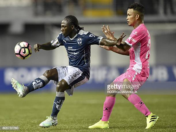 Yimmi Chara of Mexico's Monterrey vies for the ball with Amilcar Henriquez of Panama's Arabe Unido during their CONCACAF Champions League football...