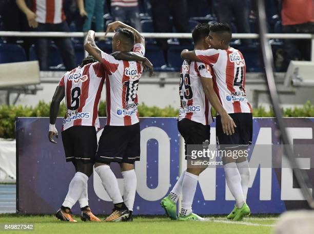 Yimmy Chara of Junior celebrates with teammates after scoring the third goal of his team during a second leg match between Junior and Cerro Porteño...
