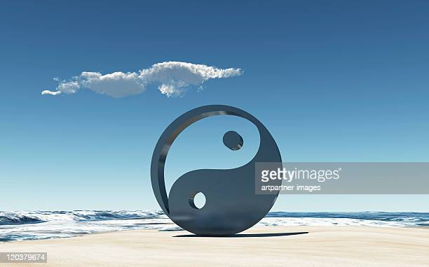Yin and Yang Symbol on a beach at the sea