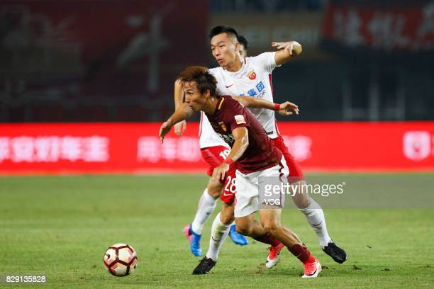 Yin Hongbo of Hebei China Fortune He Guan of Shanghai SIPG vie for the ball during the 21st round match of 2017 China Super League between Hebei...
